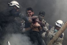 74 Of The Most Amazing News Photos Of Men rescue a boy after activists said forces loyal to Syria's President Bashar Al-Assad dropped explosive barrels in Aleppo on April Hosam Katan / Reuters 13th Documentary, Syria News, Syrian Civil War, Information Overload, Hindu Festivals, Hiroshima, What Goes On, Life Savers, Photojournalism