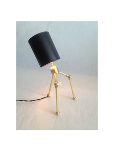 Perfect for a desk in a cozy study!      Little Guy Brass Desk Lamp. $155.00, via Etsy.