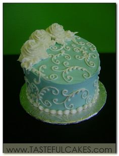 This is a nice example of a small wedding cake if you are doing a different dessert for guests, although I am not in love with the big roses.
