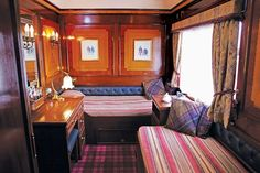 Polished marquetry walls give warmth and elegance to a Belmond Royal Scotsman sleeper car, while his... - Photo: Courtesy of Belmond