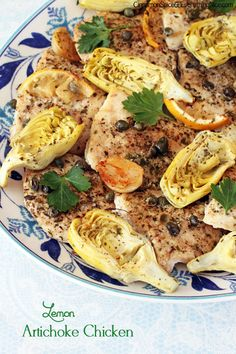 Baked Lemon Artichoke Chicken Recipe ~ chicken breasts are baked with artichoke hearts, capers, whole garlic cloves, Parmesan cheese and lemon slices plus a big glug or two of extra-virgin olive oil to help all the flavors shine
