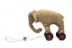 MADE TO ORDER please allow up to 10 days for me to make a little elephant on wheels especially for you. This little elephant has places to go on her little old red Meccano wheels. Little elephant is made from Osnaburg which has been dyed with strong . Elephant Love, Little Elephant, Vintage Elephant, Antique Toys, Vintage Toys, Ideas Geniales, Pull Toy, Old Toys, Felt Animals