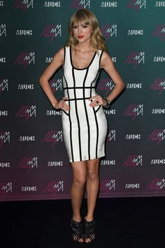 Taylor Swift looked like a total glamazon in this white bandage dress that featured structured black stripes.
