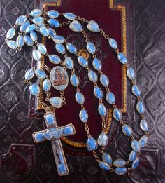 RARE Lourdes Holy Water Rosary with tiny statues in each bead Sacred Heart. This is quite an old treasure that has statues of the Blessed Virgin Mary in the Mater beads, and the Sacred Heart of Jesus in the Pater Beads. Originally made in 1958 for the 100 year Lourdes Apparition Anniversary in France, each bead would have had holy water in it (since evaporated). The center medal has the Grotto of Lourdes where the precious water came from when it all began in the later 1800's. The elaborate…