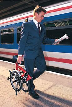 Walking down the rail platform, newspaper in one hand, Brompton folding bike in another.
