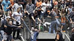 And he's a fire captain, too! Happy Father's Day. ## San Francisco Giants fan makes one-handed catch while holding baby