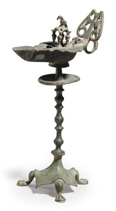 A BYZANTINE BRONZE OIL LAMP AND STAND CIRCA 5TH-6TH CENTURY A.D.
