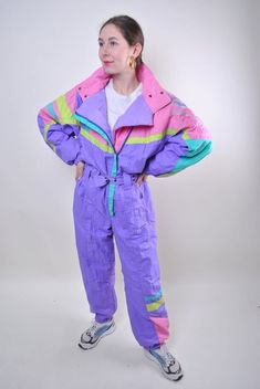multicolor ski suit, one piece purple France snow suit, Size L Welcome to TARASCOMMON.COM Unique clothing from the century. Model tall - Size: L. 44 - size on the tag. Sleeve - / ( armpit to end of sleeve) Width - / Length - / Arab Fashion, Mod Fashion, Sporty Fashion, Fashion Women, Suits For Women, Jackets For Women, Women's Jackets, Ropa Color Pastel, Unique Outfits