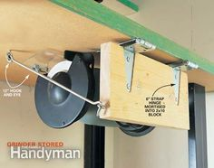 A pair of 6-in. strap hinges and a 12-in. hook and eye with an extra eyebolt are all you need to build this swing-up grinder base. First, bend one strap of each hinge. Hold the hinges in place and mark the bend. Then clamp each hinge in a vise so the mark is just above the jaws and hammer it over. Mount the grinder on a block of wood and mortise in the hinges with a router or chisel so the block sits flat on your bench. Add an eye bolt toward the back of the block and mount the hook and eye…