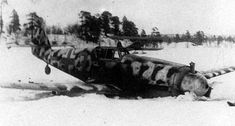 The Rudi Müller`s Bf 109 G-2/R6 after emergency landing on 19 April 1943. Note the U-2 aircraft with ski gear in the background.