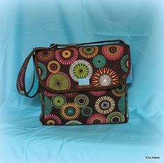 Such a fun & stylish breast pump bag!  Brown Circle Breast Pump Bag With Messenger flap by EllaAlana, $98.00