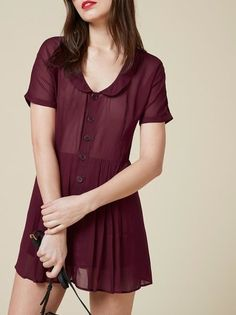 You're cute, click me. This is a mini length, relaxed fitting dress with a rounded collar.