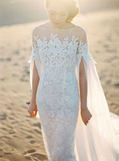 Beautiful lace wedding dress with pearl detail and veil sleeves | Bramanta Wijaya Sposa's Spring/Summer 2015 Bridal Collection: Catalyst + Oblivion