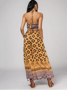 AD : Halter Bohemian Printed Cut Out Wide Leg Jumpsuit - YELLOW   Material: Polyester   Fit Type: Loose   Pattern Type: Print   Style: Fashion   With Belt: No   Weight: 0.3300kg   Package: 1 x Jumpsuit