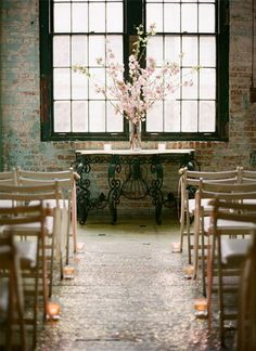 Tall flowers with vintage furniture...for ceremony