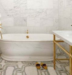 I aspire to one day have a tub I can bathe in without my knees sticking out into the cold air. I aslo love this particular example, and the mosaic tile floor.