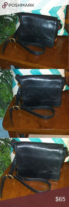 DKNY Black Leather Shoulder Bag DKNY Black Leather Shoulder Bag Wear as a shoulder bag or crossbody by adjusting the shoulder strap. Matte goldtone hardware on the sides. Excellent condition! Make an offer or hit buy now. Rock'N Ship is a top 10% seller on Poshmark, we add new items weekly. Please like or share. Dkny Bags