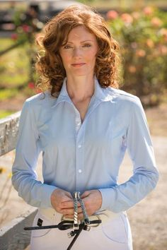 FITS Claire Silk Touch™ Shirt -    Classic looks with more technical features than ever before offered in a show shirt. Exclusive Silk-Touch fabric stretches forever; is feather weight and whisper soft; and breathes and cools while providing 4-way comfort stretch. The silhouette is streamlined to follow a woman's curves with a feminine, flattering fit for zero bulk under your show coat. Powermesh gussets ventilate under the arms and eliminates seams for chafe free comfort.