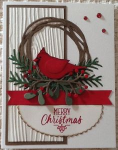 handmade Christmas card ... punch art cardinal ... die cut Swirly wreath and greens ... white embossing folder wood grain panel ... tons of texture ... earthy winter look ... Stampin' Up!