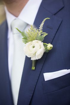Navy blue + white groom outfit idea - navy blue suit with white white ranunculus + greenery {Captured by Kate Photography}