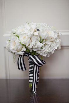 classic white bouquet w/ a black and white stripped ribbon /// Photography: SMS Photography, Florals: Prive Floral