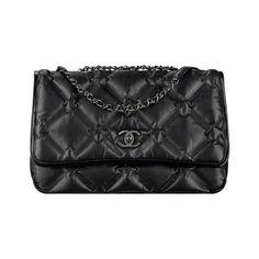 Black CHANEL Flap Bag in Calf Skin and Ruthenium Metal.