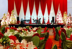 Classic red and green Christmas stage decor | #christmas #party #stage #EventuresInc