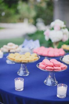 macaroons on a blue table cloth http://www.itgirlweddings.com/blog/preppy-american-wedding