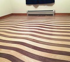 Floor Installer's First Foray Into Bending Wood Creates Wave Illusion - Wood Floor Business Magazine