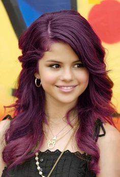 i've been considering purple hair for a while now... maybe nothing this drastic. but i love selena. she's adorable. and is that a mickey mouse necklace i see? :)