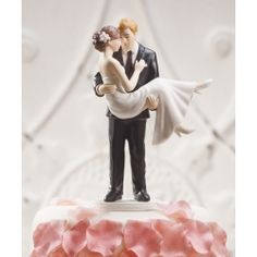 NEW ARRIVAL FOR 2013 - This couple shows all the excitement of a Bride and Groom about to start off on their first journey together. The Groom carries his Bride over the threshold to begin their lives together as Husband and Wife. A cake topper for the true romantics. Visit www.angelicweddings.co.uk if you wish to purchase this amazing cake topper.