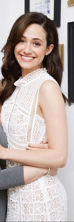Who made Emmy Rossum's white lace dress?