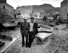 Ferdinando Scianna 1975 Italy, Sicily,Sant'Elia:Two fishermans on sunday.
