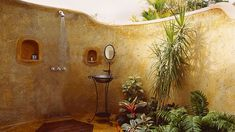 Outdoor Shower -- neat stucco facade and incorporation of cut-outs for soaps.  Mirror and sink are nice touches, but practicality unknown.