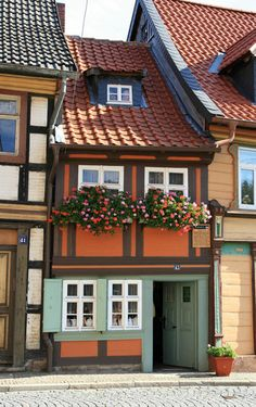 "The smallest house of Wernigerode / Germany. It measures up to the eaves 4.20 m, is 2.95 m wide and has a 1.70 m tall door. The only room of the house has 10sqm ""living space"". My great-grandmother was born there in 1904."