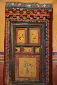 Painted door and doorway. Tibet