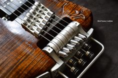 INNOVATION ~~~~~~~ Headless-Guitar-Bridge Design of Rick Toone ~ Rick is an amazing inventor and luthier! This is merely the tip of his iceberg ~ PLEASE, do yourself a favor and visit his website >  http://www.ricktoone.com/ ~ Bob~ [the link below is NOT the website, just some fabricated pinterest page ...]
