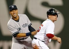 BOSTON, MA - AUGUST 3: Derek Jeter #2 of the New York Yankees smiles after making the out on Christian Vazquez #55 of the Boston Red Sox in the second inning at Fenway Park on August 3, 2014 in Boston, Massachusetts. (Photo by Jim Rogash/Getty Images)