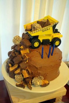 Joey's cake! Thinking rectangular cake with 3 (dirt road) with oreo's / boulders ( bite size chocolates) with construction trucks