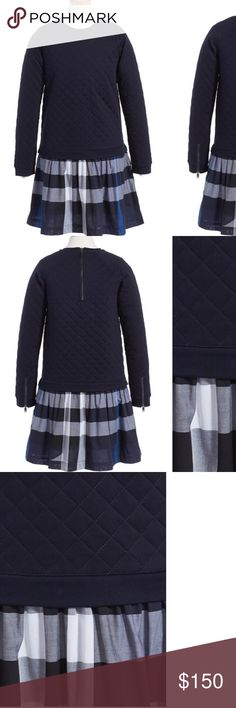 Burberry girls' Orlia dress (NWT) Size runs small order 1 size up.                  Color: Navy Blue and checkered on skirt.         Diamond quilting and zip details at the sleeves add irresistible charm to a comfy sweater-dress completed with a crisp, classic check-print skirt. Back zip closure Skirt has cotton lining 100% cotton Machine wash cold, tumble dry low By Burberry; imported Kids' Wear Burberry Dresses Casual