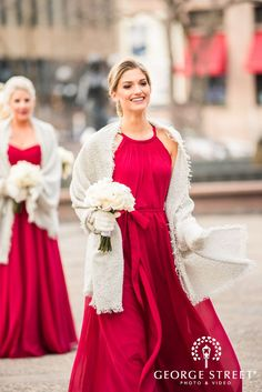 A gorgeous winter wedding styled in vibrant long chiffon, red bridesmaid dresses!