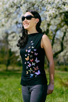 Luxury romantic black top with colorful butterflies from new collection by Mia-made. It is made of very fine black viscose fabric. Colorful butterflies of different sizes with smooth satin finish are applied on front side of the Top. Back side is plain black, with no pattern. Classic cut