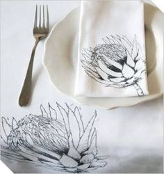 On this beautiful protea design table cloth, flowers seem to grow from the edges into the centre of the table. The middle of the design is left w. South African Decor, South African Design, African Fashion, Flower Art, Screen Printing, Prints, Fabric Design, Watercolour Techniques, Diy Wedding