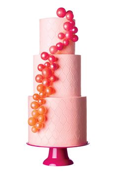 Brides.com: . Cake Alchemy, New York, NY. Go for full-on whimsy with a bubbly (pun intended) wedding cake like this one. The etched pattern adds graphic appeal to the pale pink fondant.  Light pink etched wedding cake with bubbles, $12 per slice (serves 75), Cake Alchemy  See more pink wedding cakes.