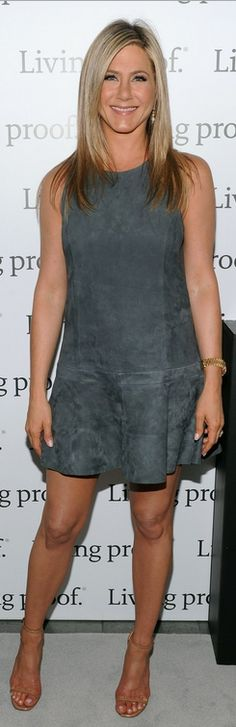 Who made Jennifer Anistons gold watch and gray suede dress that she wore in New York on May 8, 2013?