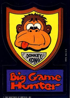 """Topps Donkey Kong Trading Cards - Card 21 :-: Excellent card with good color is this one in the series. The color features the head of our good mate Kong on the hunters trophy shield with the caption """"Big Game Hunter""""."""