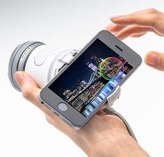 Olympus AIR - It's a handheld interchangeable lens camera completely controlled with smartphones. Olympus wedged the mirrorless, wi-fi & Bluetooth-enabled, 16-megapixel camera—its sensor, storage, battery, & camera functions into a handheld device barely larger than a typical DSLR lens. | via werd.com