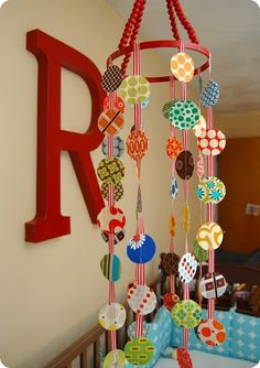 DIY baby mobile with circles and fabric or paper... @Holly Elkins Bonner   We could DO this!!!