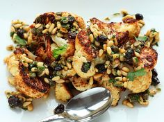 Caramelized roasted cauliflower with a pine nut, raisin, and caper vinaigrette