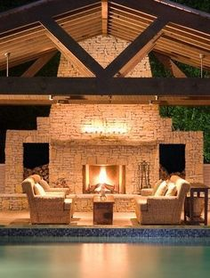 Beautiful outdoor living space - love the covered patio with the large beams & the cozy fireplace & the seating area all next to the swimming pool